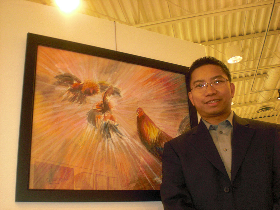 """Jhun and his painting, """"Sabong"""" (A private collection of Mr & Mrs Nell and Darrell Ross"""