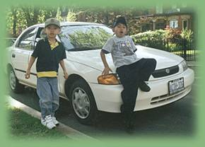 Bon and Josh with our first car in Canada, Mazda Protege